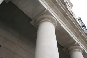 A jesmonite column on the outside of a building