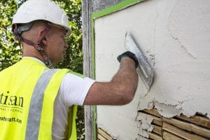 image of lime render applied over timber laths